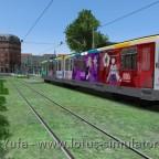 Gras und bunte Bahn am Hauptbahnhof